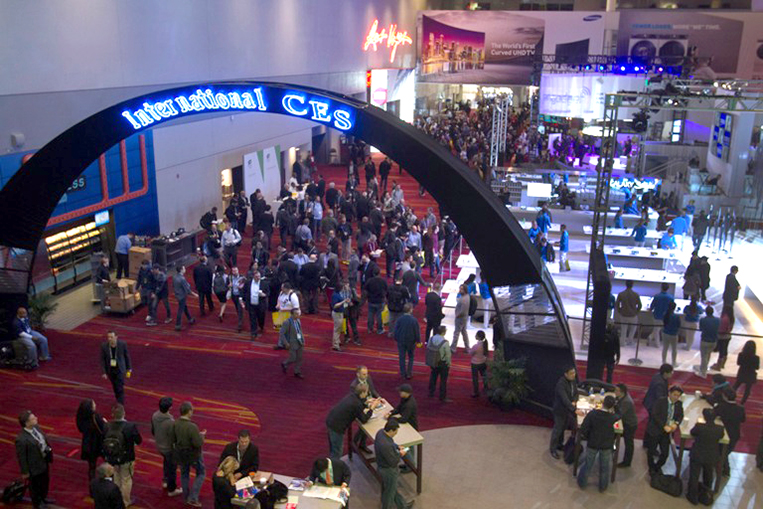 Attendees crowd at the lobby of the Las Vegas Convention Center